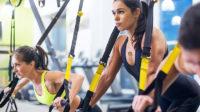 women on TRX in gym