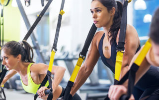 women on TRX in gym