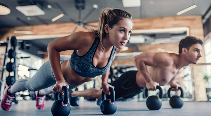 two people working out in gym